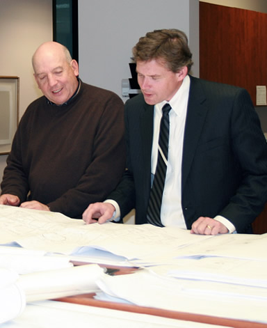 Johnny Carrier of CMC reviewing mausoleum construction documents